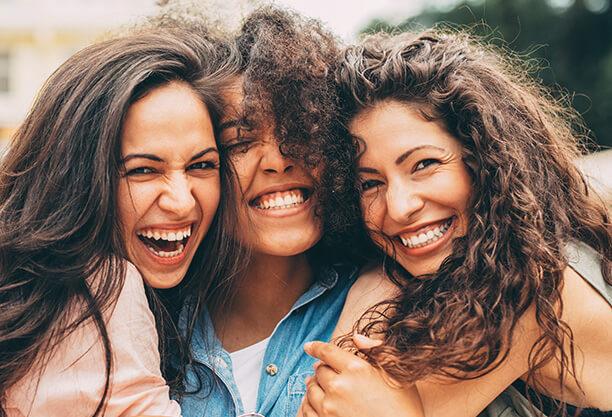 three smiling friends