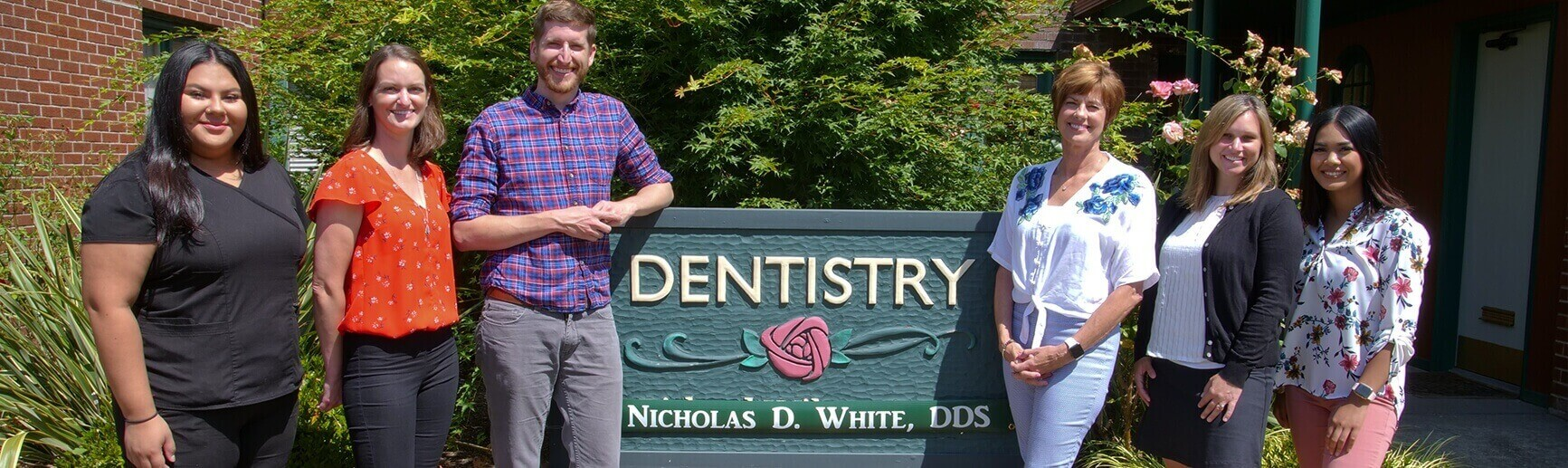 Portland dentist Dr. White and his team