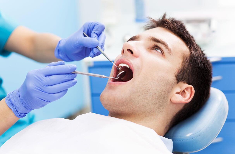 dentist examining a patient's teeth