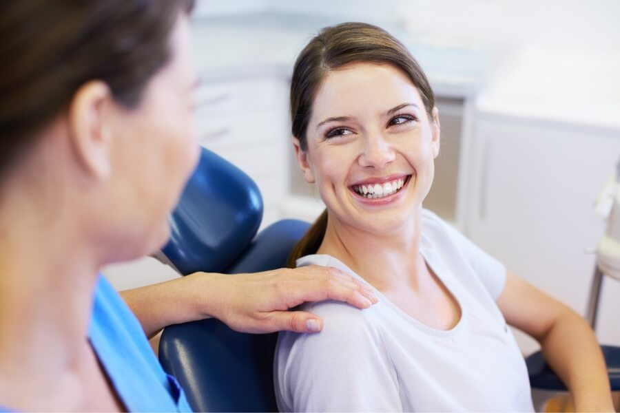 Brunette woman smiles at the dentist in Portland, OR