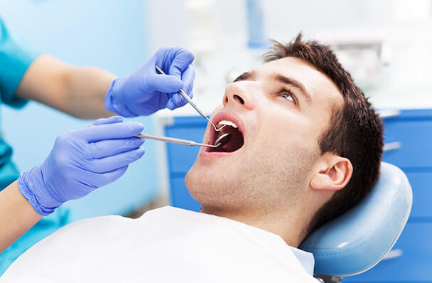 a young man getting a dental exam
